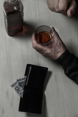 pensionary: Old aged divorcee falls into an alcoholism Stock Photo