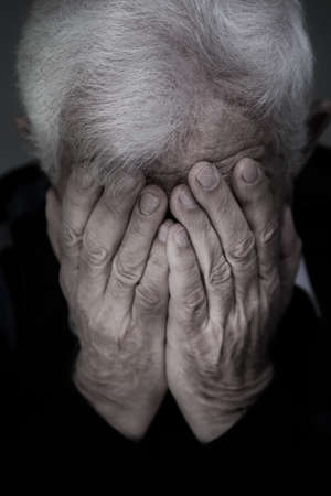 Portrait of old man with white hair crying Stock Photo