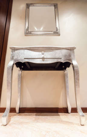 Silver table with drawer in modern interior photo