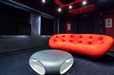 home cinema: View of red sofa at home cinema