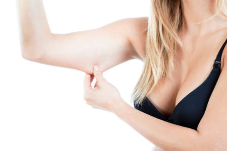 Beautiful breasts: Horizontal view of woman showing flabby arm