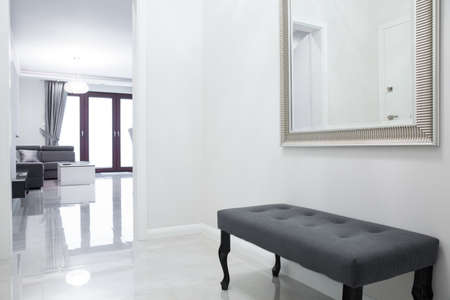 apartment: Gray bench in anteroom in luxury apartment Stock Photo
