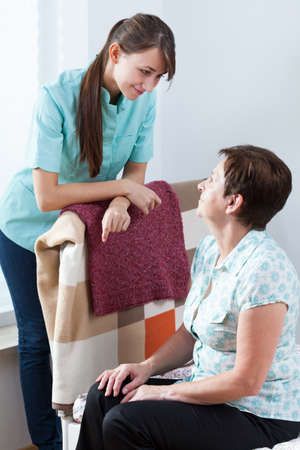 caring nurse: Young caring nurse and her female patient Stock Photo
