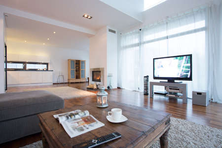 Spacious and bright living room with tv in residence