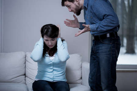 Young terrified woman with her screaming husband photo