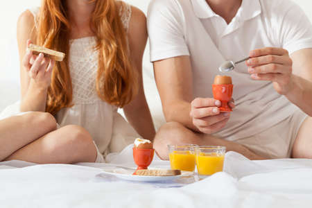 Couple eating breakfast together at the weekend Stock Photo