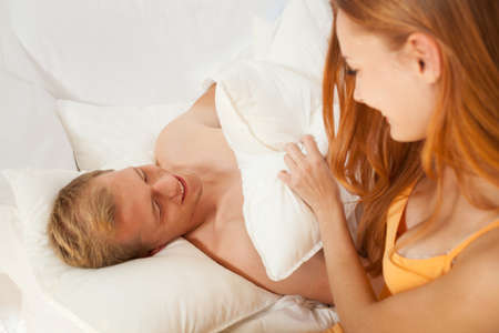 truelove: Pillow fight between couple at start of the morning