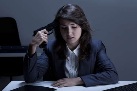 commit: Depressed businesswoman going to commit suicide in the office
