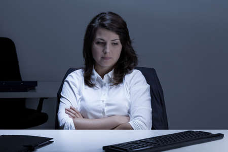 stressed business woman: Image of woman with depression working in office Stock Photo