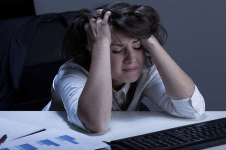 helpless: Horizontal view of helpless woman during overtime Stock Photo