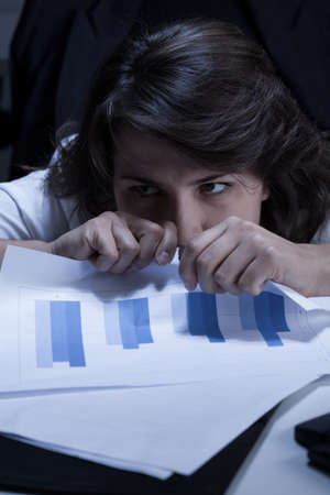 working overtime: Woman with depression working overtime in the office Stock Photo