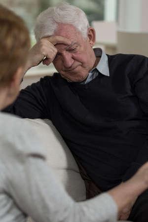 unhappy family: Portrait of sad and resigned elder man