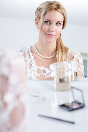 getting ready: Happy bride with ready makeup