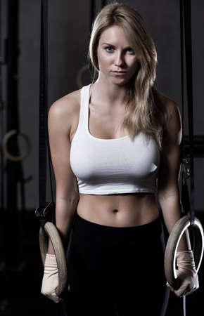 beautiful blonde: Portrait of beauty woman during crossfit training