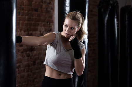 Horizontal view of beauty woman training boxing