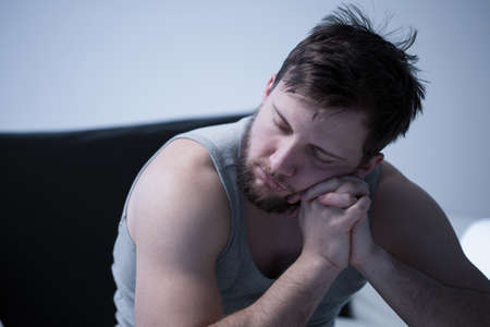 sitting up: Portrait of man sleeping while sitting up