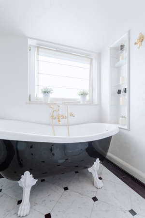 white tile: Black and white bath in luxury bathroom