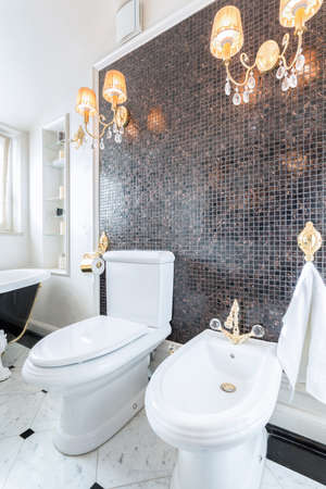 sumptuous: Vertical view of crystal chandeliers in luxury toilet Stock Photo
