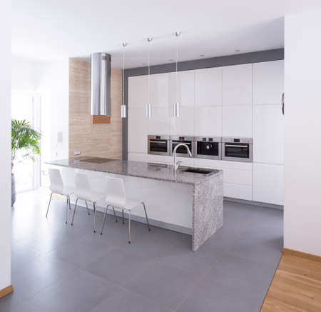 kitchen countertops: Contemporary kitchen interior in beauty detached house