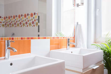 bathroom wall: Two washbasins in toilet in modern house Stock Photo