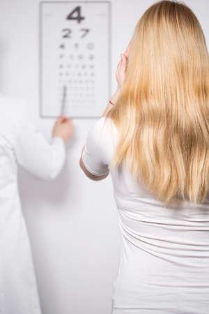 Back of woman having her eyes examined Reklamní fotografie