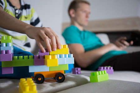 play blocks: Close-up of boy playing with colorful blocks in family room