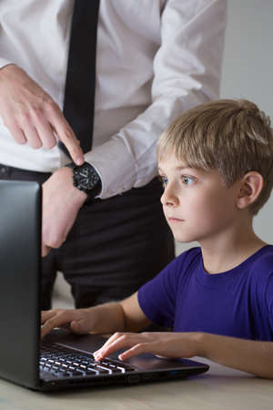 game time: Little boy and has to end game time Stock Photo