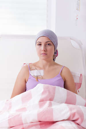 woeful: Young cancer woman lying in hospital bed Stock Photo