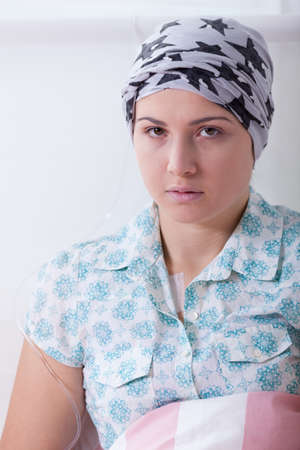 woeful: Close-up of girl with leukemia wearing headscarf