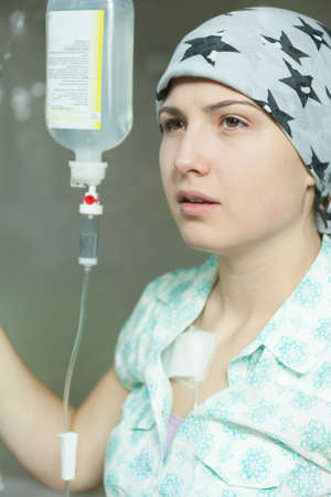 bald girl: Portrait of cancer girl being on a drip Stock Photo