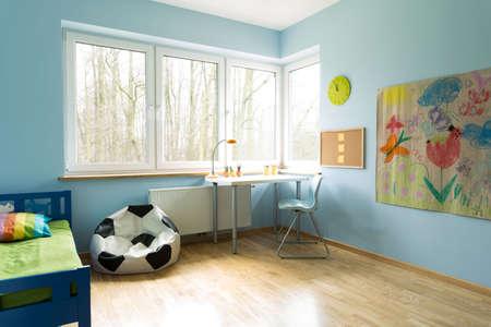 Fashionable new kid's room with wooden floor Stockfoto