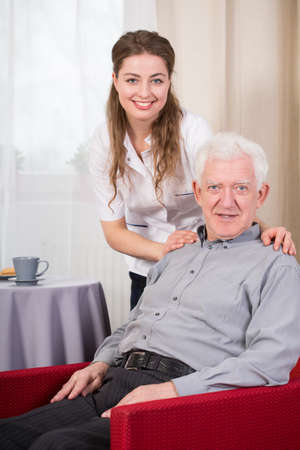 social care: Portrait of social care worker and senior man Stock Photo