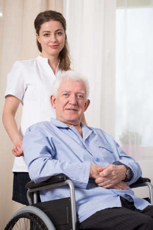 mobility nursing: Disabled man using wheelchair at nursing home Stock Photo
