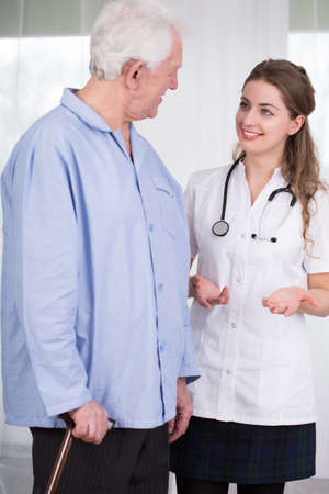 geriatric: Geriatric patient talking with young female doctor
