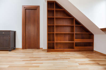 View of wooden bookshelf in the attic