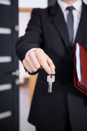 Close-up of the keys in the hands of a real estate agent photo