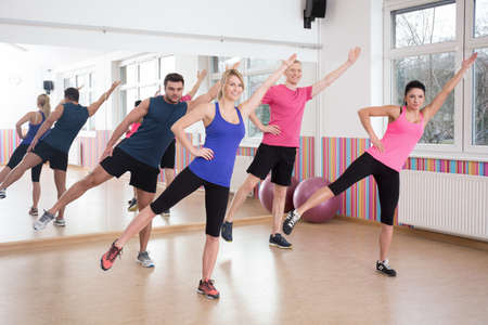 4 people: Four young people doing aerobics on fitness classes Stock Photo
