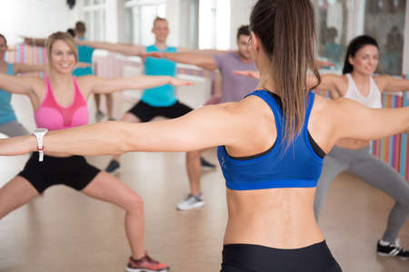 instructor: Young aerobics instructor showing exercises during fitness classes Stock Photo