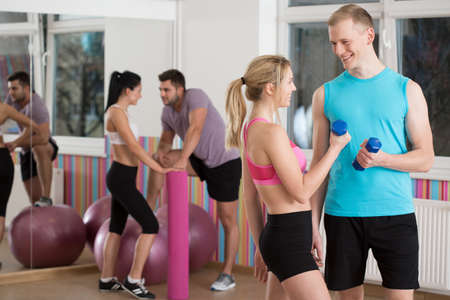 Two couples flirting during fitness classes photo