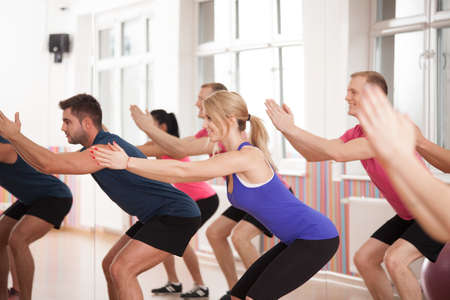 strengthening: Group of people strengthening bottom muscles during fitness classes