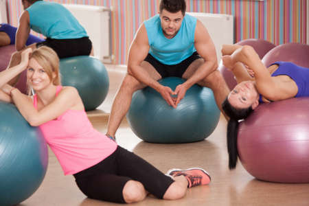 fit ball: Tired young people after hard training in fitness club Stock Photo