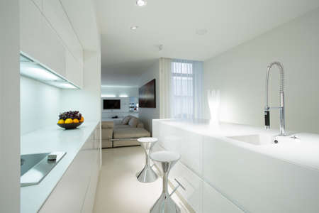kitchen countertops: Interior of white kitchen in contemporary house Stock Photo