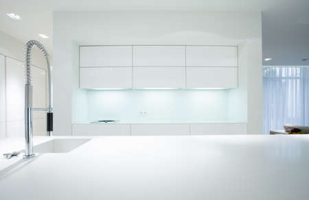 kitchen: Horizontal view of simple white kitchen interior Stock Photo