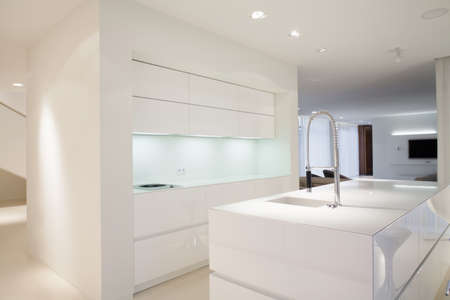 kitchen countertops: Bright kitchen interior with simple white cupboards Stock Photo