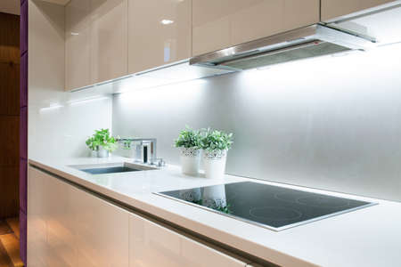 kitchen: Interior of modern kitchen with induction hob