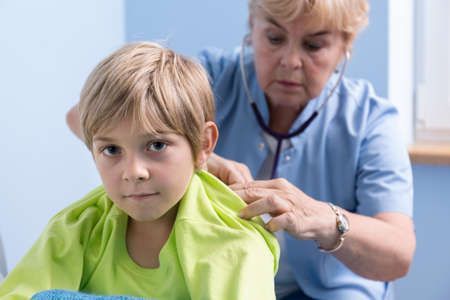 auscultation: Sick little boy in hospital and his chest auscultation