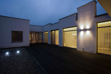 front view: Detached house at night - view from outside