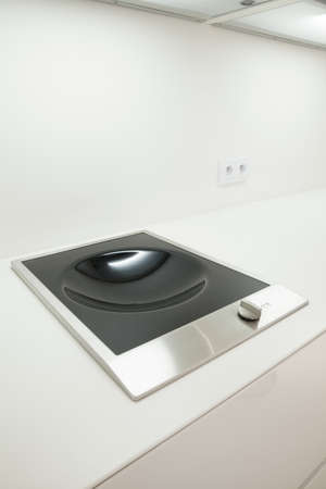kitchen countertops: Close-up of induction hob ideal for wok Stock Photo