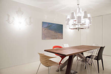 home  lighting: Designed pendant and chairs in modern dining room