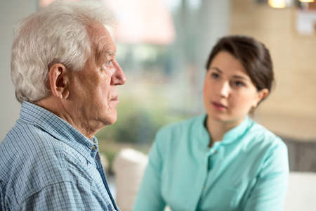 Lonely senior man staying in retirement home Stock Photo
